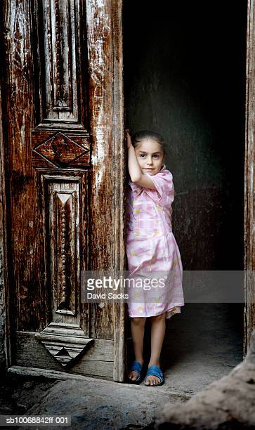 Portrait of girl (4-5) in doorway