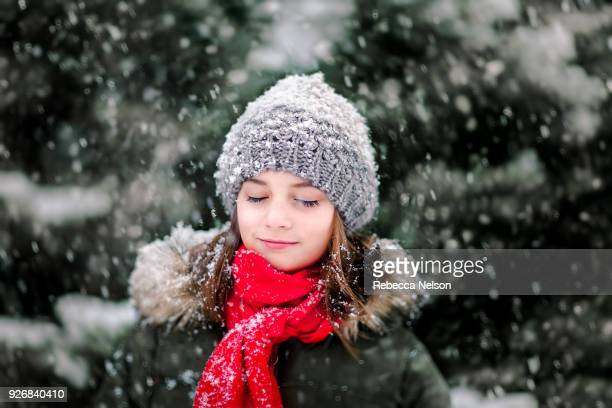 portrait of girl in falling snow - rebecca nelson stock pictures, royalty-free photos & images