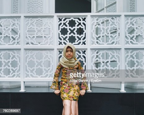 Portrait Of Girl In Hijab Leaning Against Railing