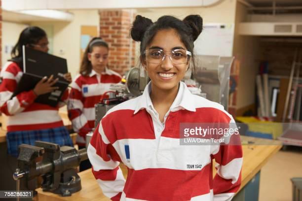 Portrait of girl in school workshop