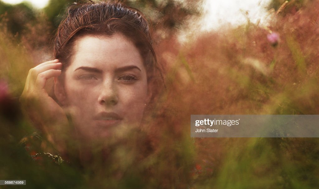 Portrait of girl in soft meadow grasses : Stock Photo