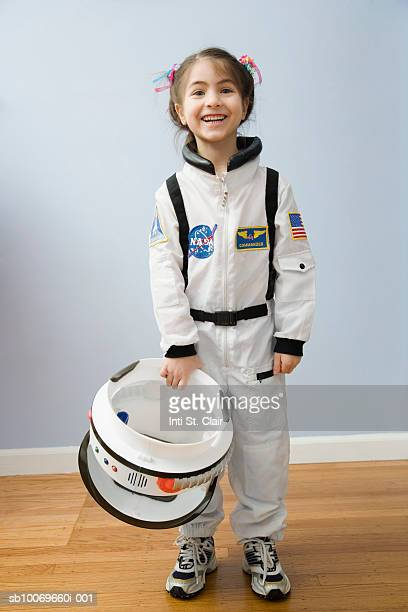 Portrait of girl (4-5 years) in space costume