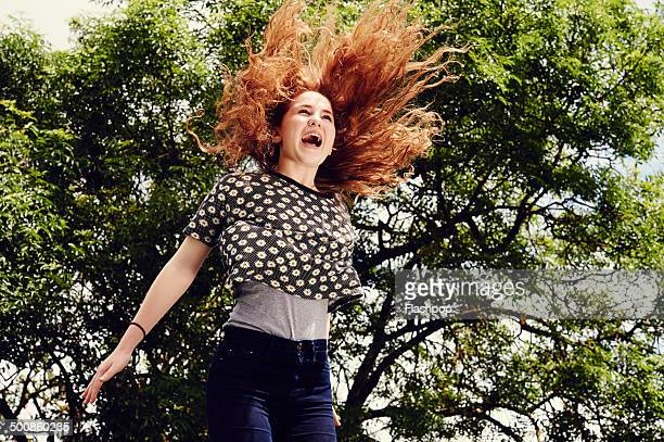 Portrait of girl jumping in the air