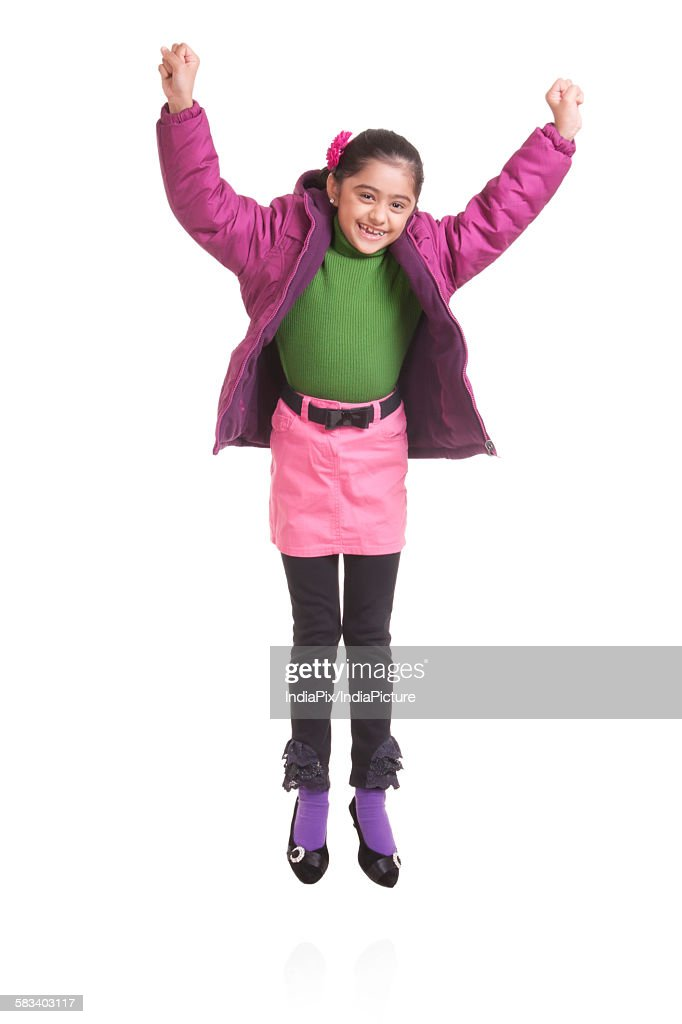 Portrait of girl jumping in the air : Stock Photo