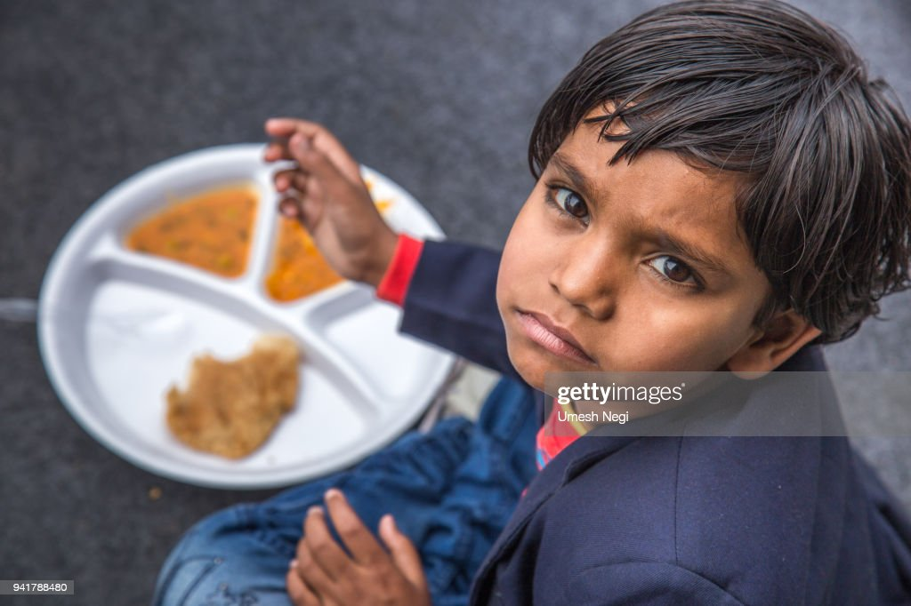 Portrait of Girl kid having mid-day meal in Indian school. : Stock Photo