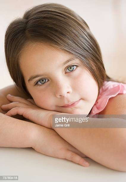 Portrait of girl leaning head on arms