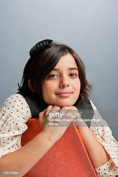 """portrait of girl leaning on the back of a chair - """"compassionate eye"""" imagens e fotografias de stock"""