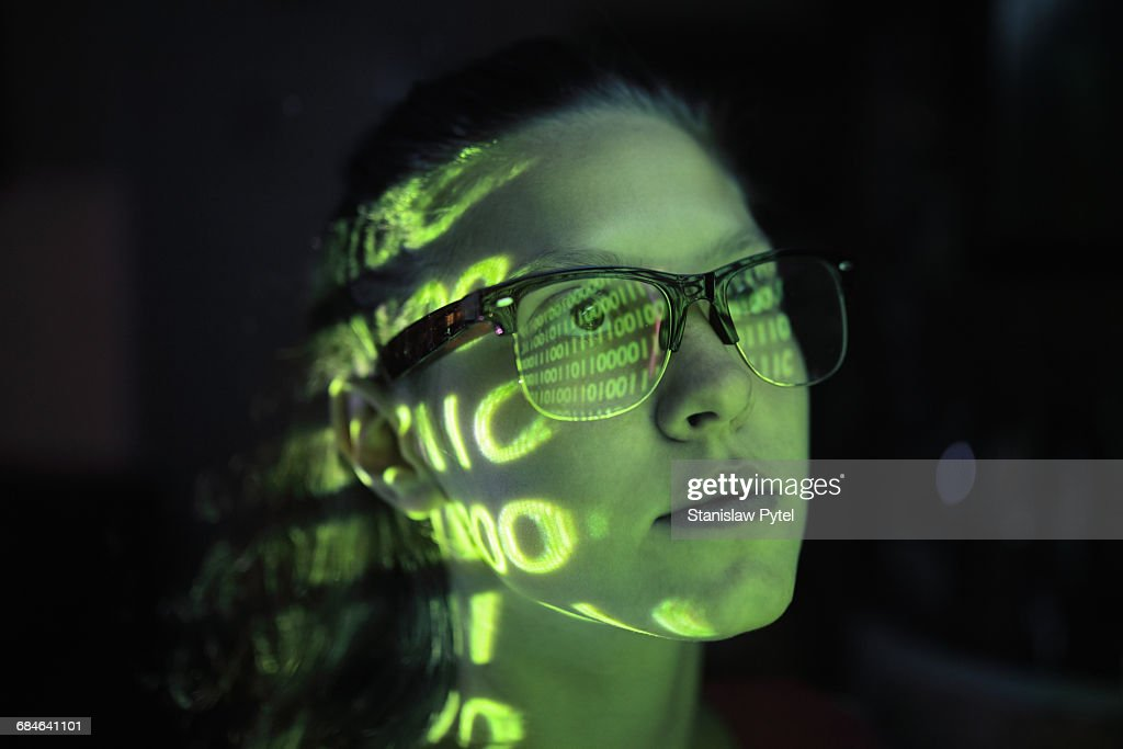 Portrait of girl lighted with green numbers : Stockfoto