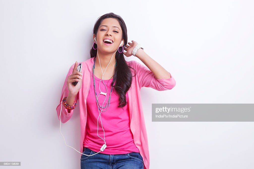 Portrait of girl listening to music : Stock Photo
