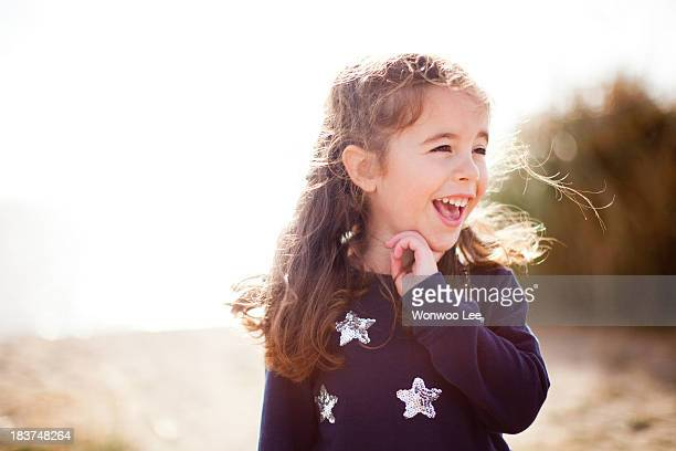 Portrait of girl looking away, laughing