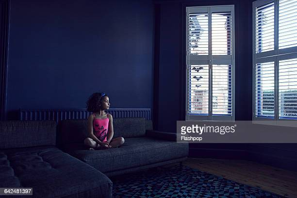 Portrait of girl looking out of window