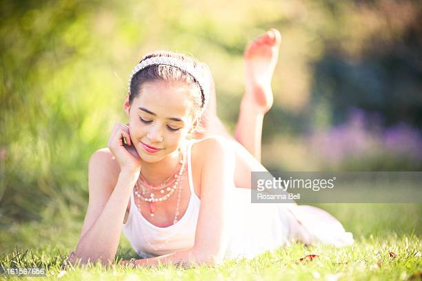 Portrait of Girl lying down in the grass