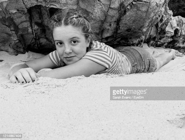 portrait of girl lying down on beach - sarah sands stock pictures, royalty-free photos & images