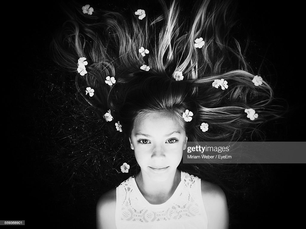 Portrait Of Girl Lying Down With Flowers In Hair Stock Photo Getty