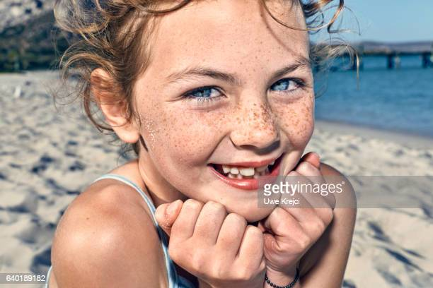 Portrait of girl on beach, close up