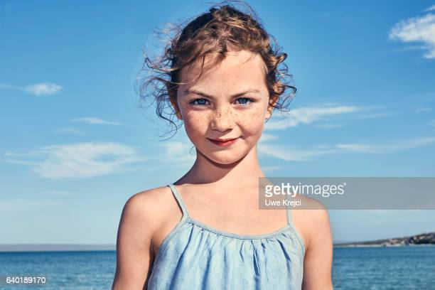 Portrait of girl (7 - 8 years old) on beach