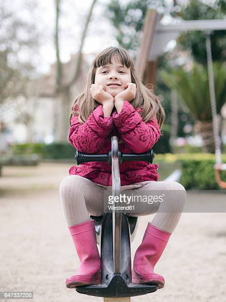 portrait of girl on playground - little girls in tights stock photos and pictures
