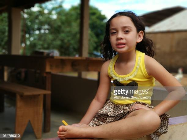 Portrait Of Girl On Retaining Wall