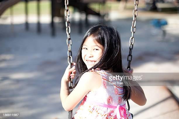 Portrait of girl on swing