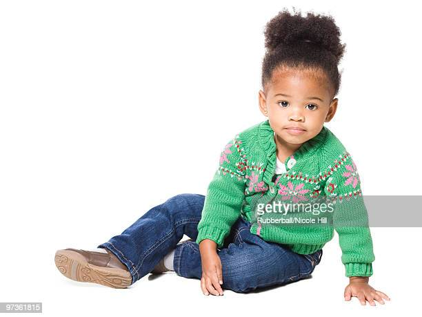 Portrait of girl (18-23 months) on white background