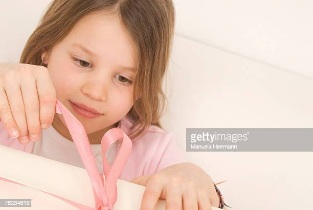 portrait of girl opening present