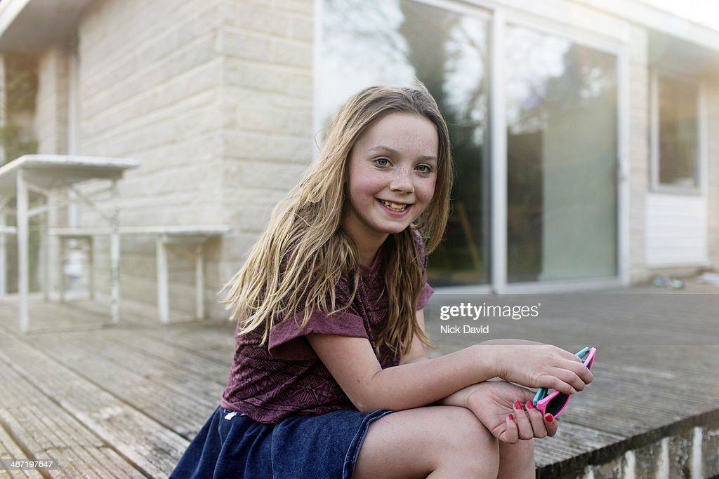 Portrait of girl outside her home : Stock Photo