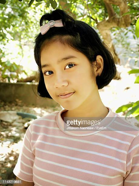 portrait of girl - very young thai girls stock photos and pictures