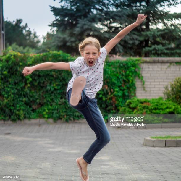 portrait of girl practicing kung fu - daily sport girls stock pictures, royalty-free photos & images