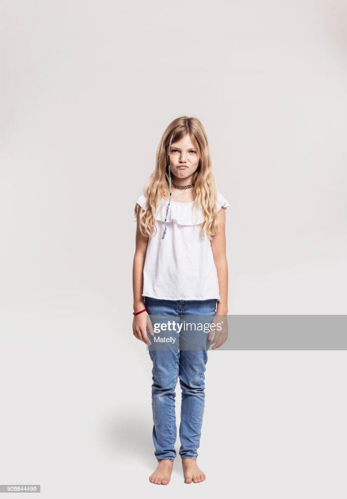 Portrait of girl pretending to sulk : Stock-Foto