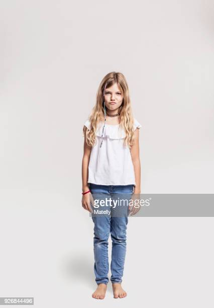 portrait of girl pretending to sulk - white pants stock pictures, royalty-free photos & images