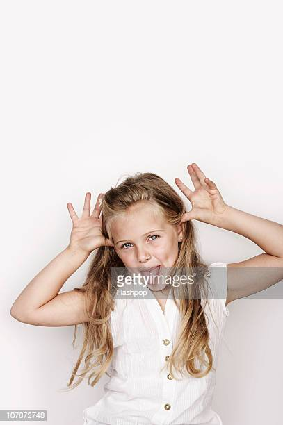 portrait of girl pulling a funny face - gesturing stock pictures, royalty-free photos & images