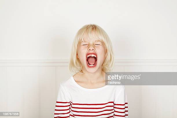 portrait of girl pulling funny faces - one girl only stock pictures, royalty-free photos & images