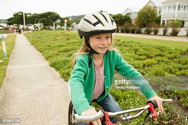 Portrait of girl (8-9) riding bicycle