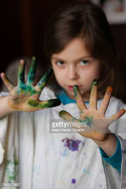 portrait of girl showing watercolor paint on palm - marty hardin stock photos and pictures