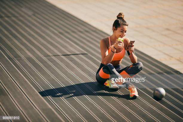 portrait of girl sitting on stairs after exercising. - sportswear stock pictures, royalty-free photos & images