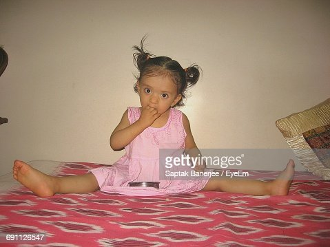 Isolated Young Woman Sitting In Crossed Legs On The Ground