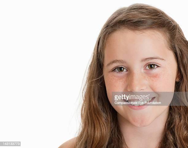 "portrait of girl (10-11), smiling - ""compassionate eye"" fotografías e imágenes de stock"