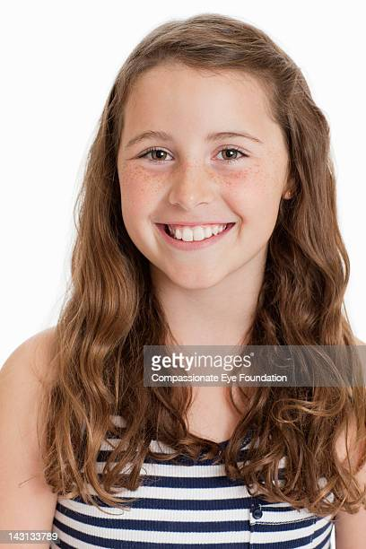 "portrait of girl (10-11), smiling - ""compassionate eye"" stock-fotos und bilder"
