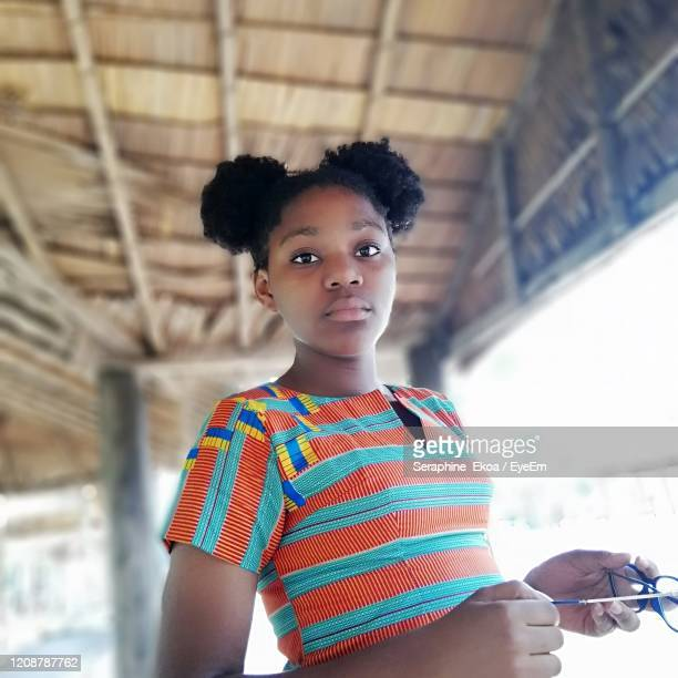 portrait of girl standing against ceiling - democratic republic of the congo stock pictures, royalty-free photos & images
