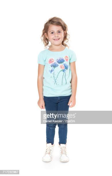 Portrait Of Girl Standing Against White Background