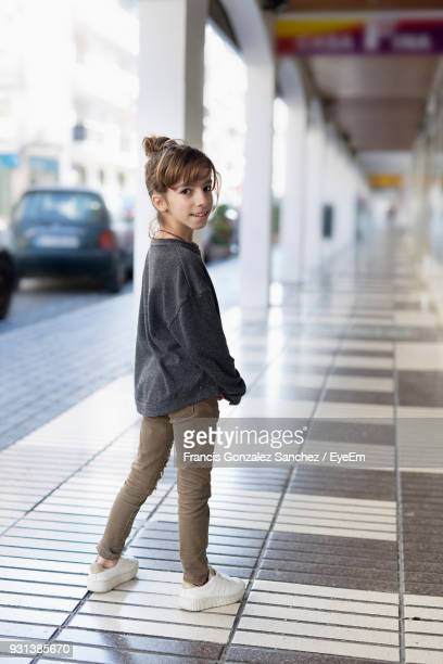 Portrait Of Girl Standing In Corridor