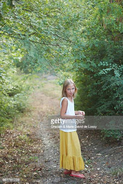 Portrait of girl standing in woodland, Buonconvento, Tuscany, Italy