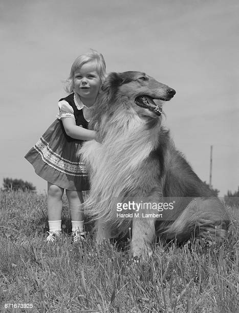 portrait of girl standing with pet dog - pawed mammal stock pictures, royalty-free photos & images
