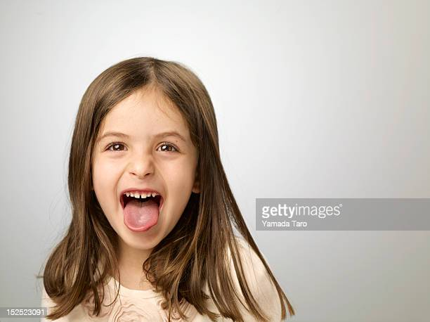 Portrait of girl sticking out tongue