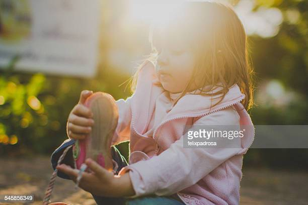 portrait of girl (2-3) taking off shoe - girl strips stock pictures, royalty-free photos & images