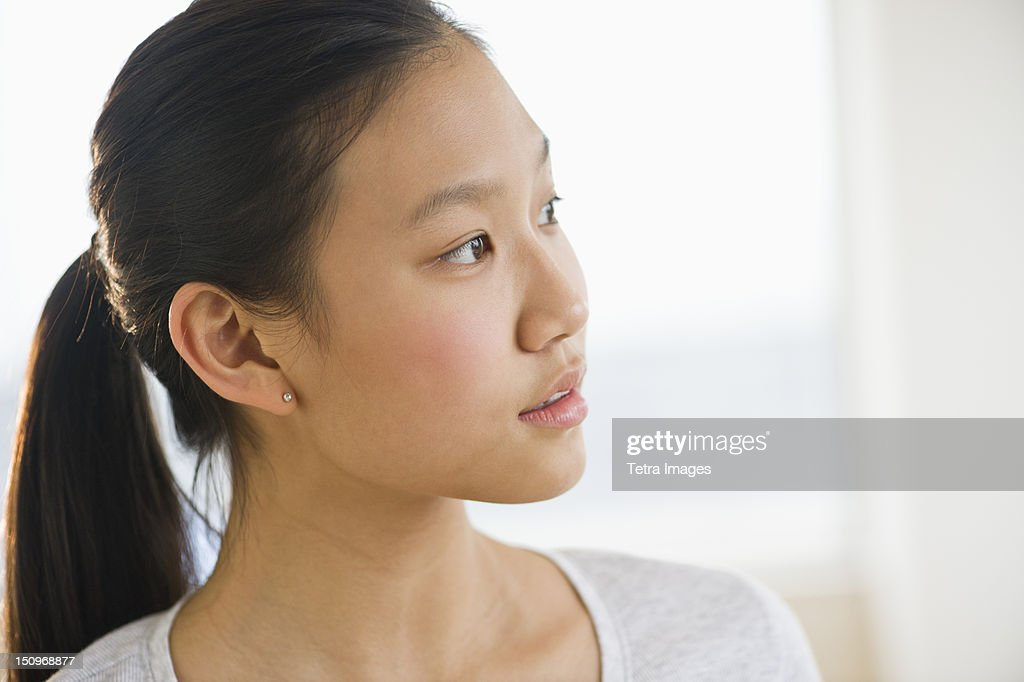 Portrait of girl (14-15) thinking : Stock Photo