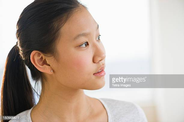 portrait of girl (14-15) thinking - korean teen stock pictures, royalty-free photos & images