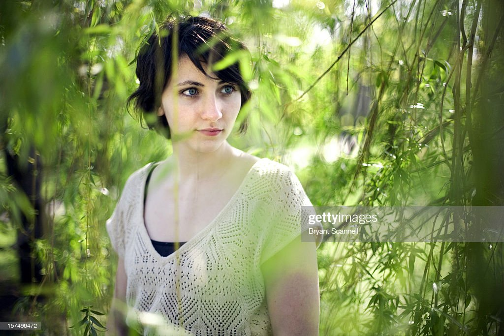 Portrait of Girl Through Leaves : Stock Photo