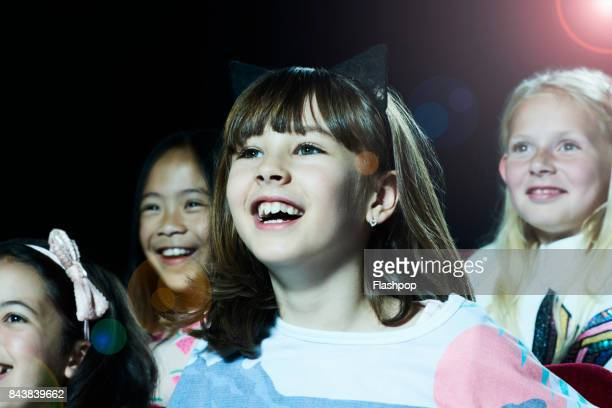 portrait of girl watching a movie at the cinema - children theatre stock photos and pictures
