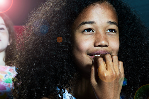 Portrait of girl watching a movie at the cinema - gettyimageskorea